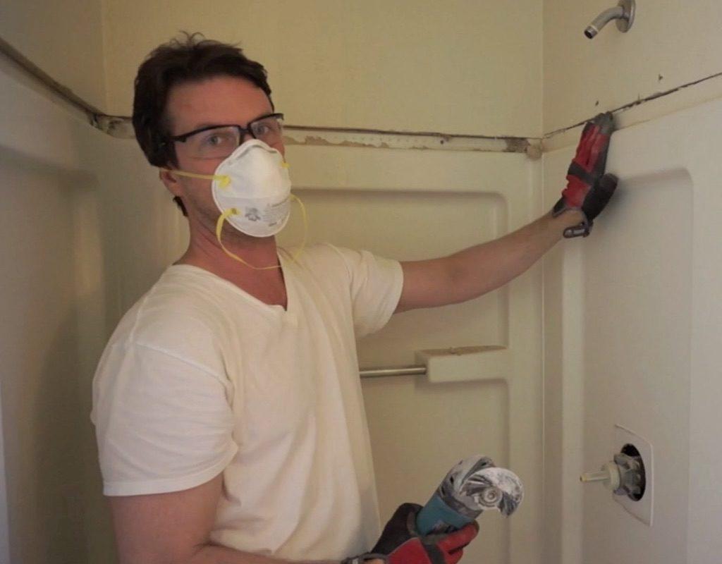 Worker standing in shower