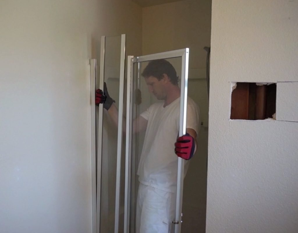 Man removing shower door
