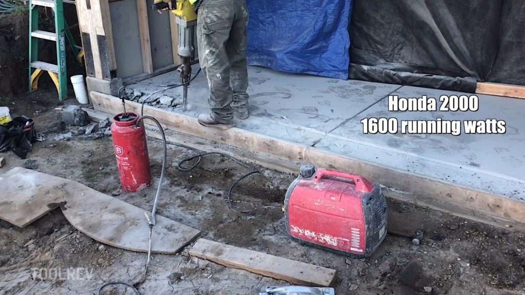worker using jackhammer with small generator