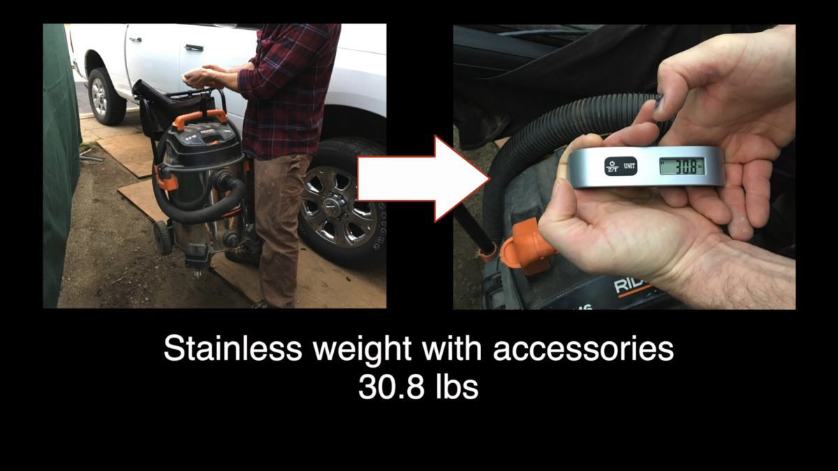 ridgid stainless steel shop vac being weighed at 30.8 pounds with accessories