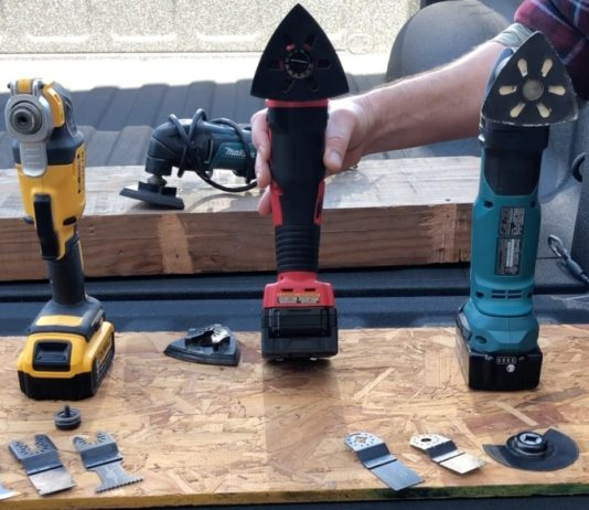 three corded and one cordless multi-tool on truck bed