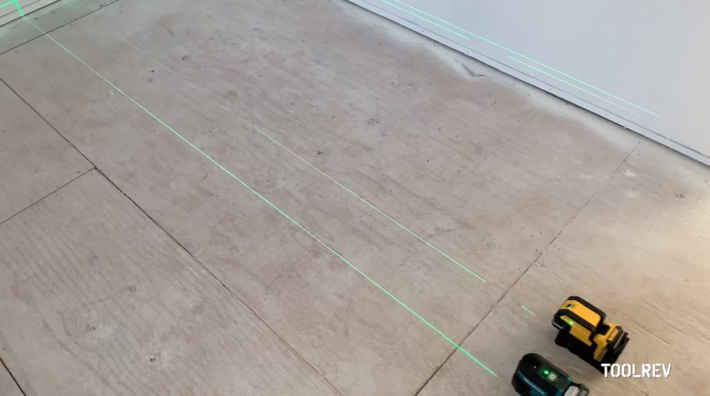 Two laser level lines on wood floor