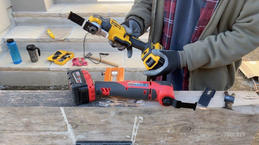 worker holding dewalt multi tool